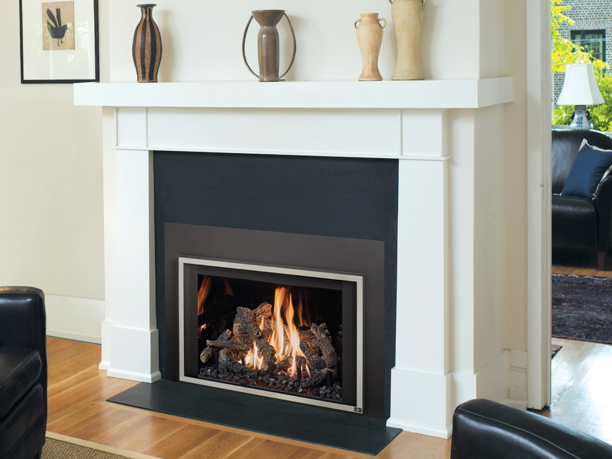 Gas fireplace insert paired with a white mantel