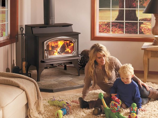 Mother and child next to wood burning stove