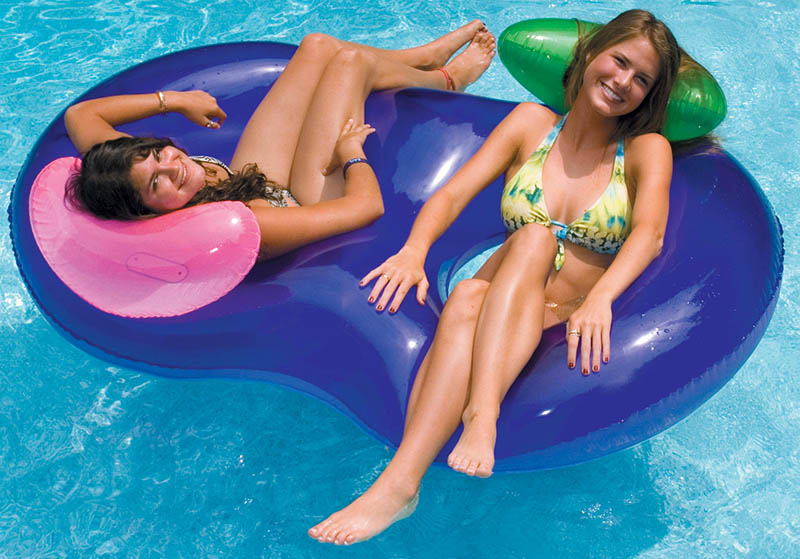 Girls floating in an Omega Pool