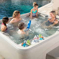Family in a portable fantasy spas hot tub