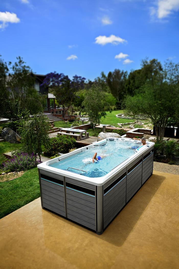 Athlete swimming in low cost swim spa