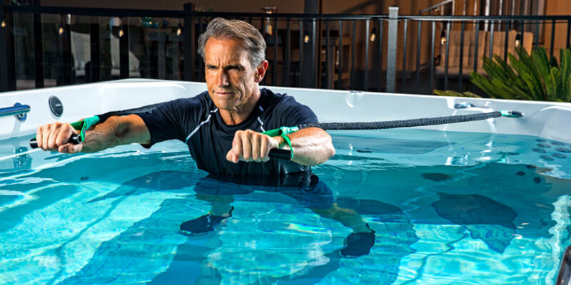 Man comparing swim spa bands in pool