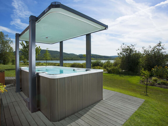 Legend Covana Cover raised over swim spa by lake