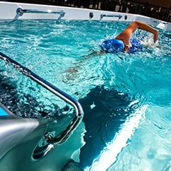 Athlete swimming in swim spa in Oklahoma City