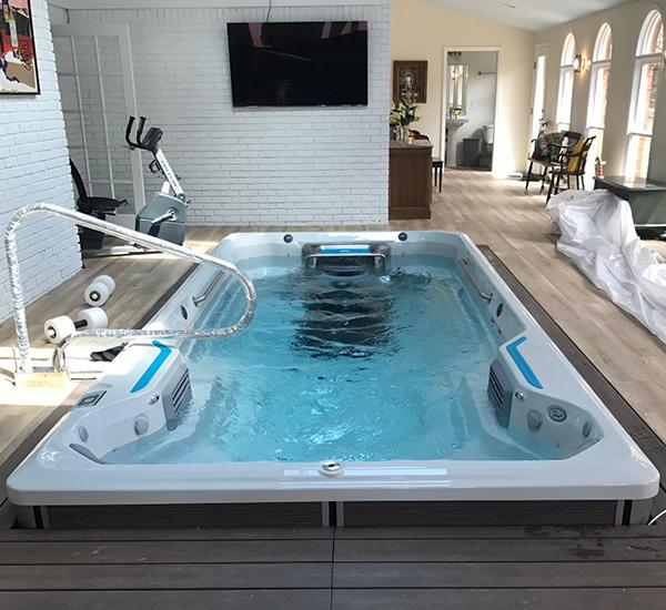 In-ground swim spa installation indoors