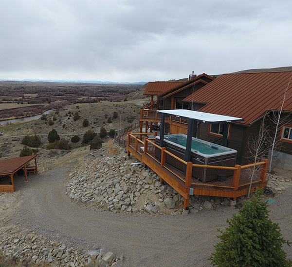 Swim spa installation on deck with canyon view