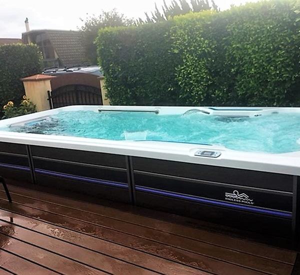 In-ground swim spa installation on back patio