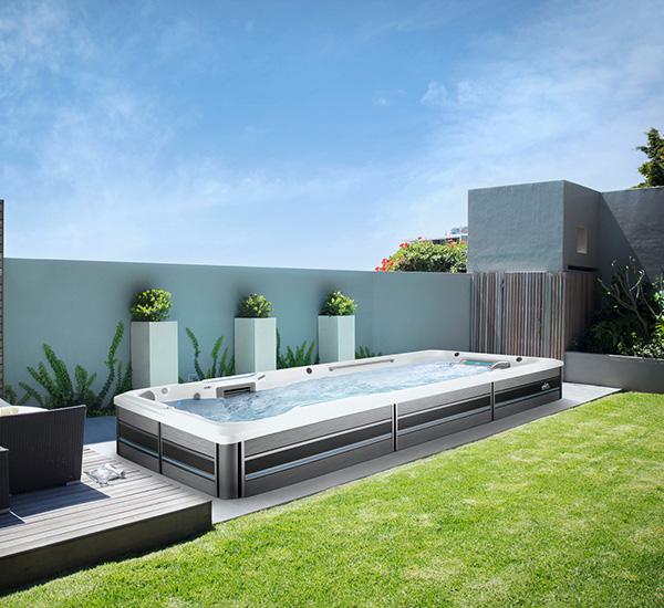 In-ground swim spa installation in backyard