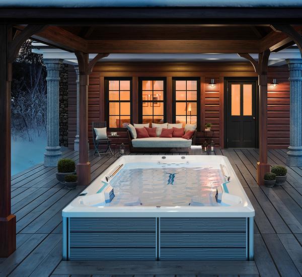 Swim spa installation next to patio furniture on deck