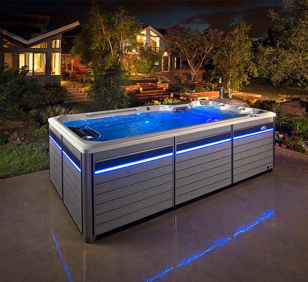 Swim spa installation in backyard at night