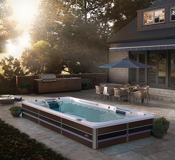In-ground swim spa installation on patio